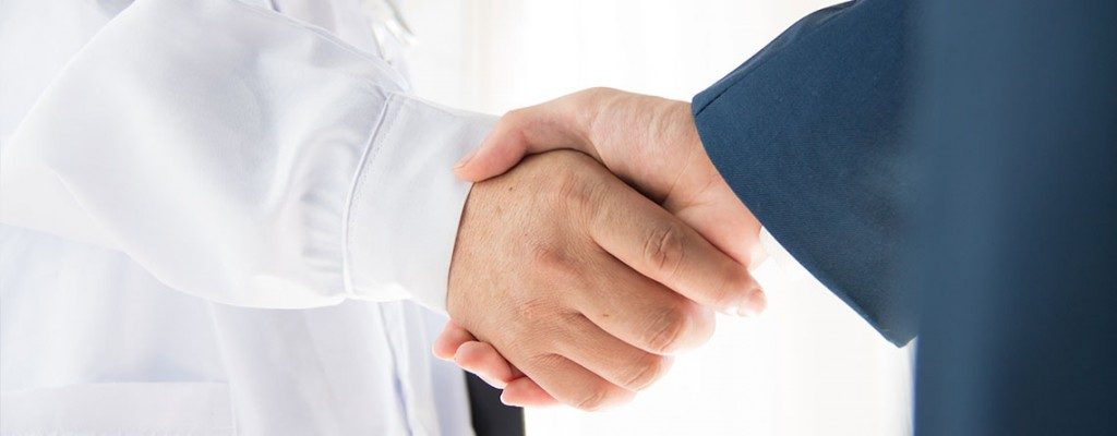 Doctor to Businessman Handshake at Nielson Financial Services